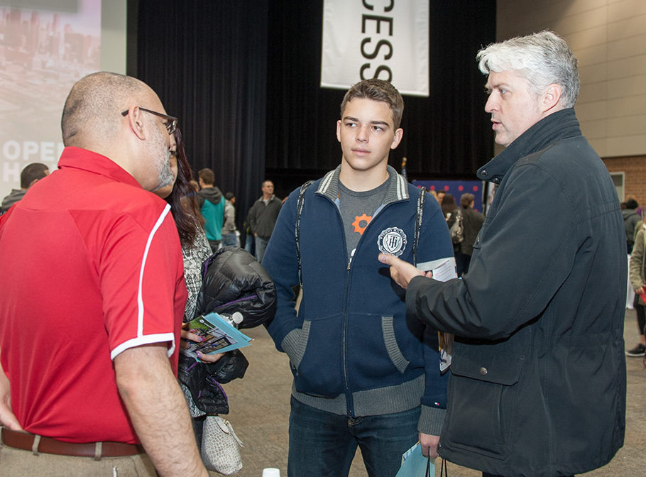 Visitors learning about UIC at Open House