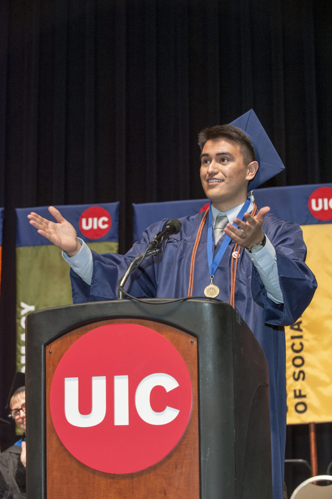 Photograph of a CUPPA graduate giving a speech during the ceremony.