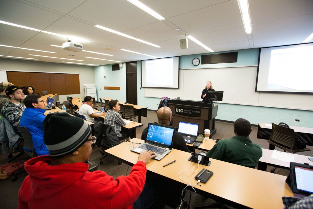 Professor Kelly LeRoux teaching an undergraduate class.