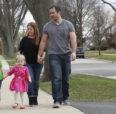 Family Walking in Suburbs