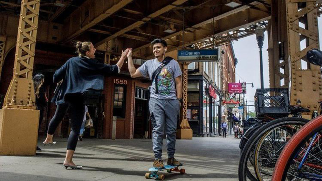 Commuter high fives a skate border in Wicker Park