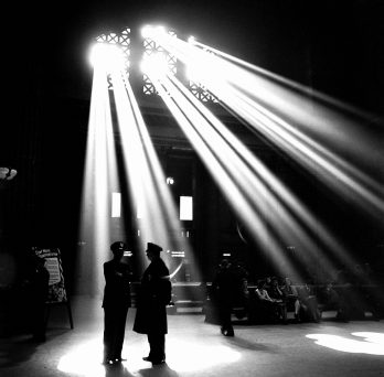 light shining through windows above two unidentified police officers