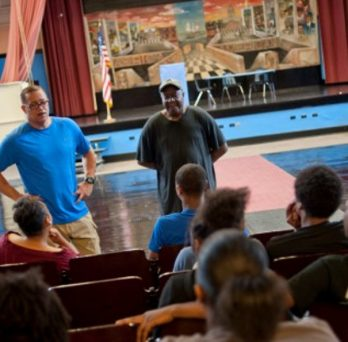 Teens Hired To Renovate Auditorium